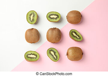 Flat lay with kiwi on two tone background, top view