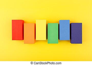 LGBT flag made of rectangular geometric figures on yellow background.