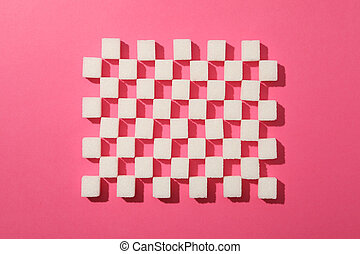 Flat lay with sugar cubes on pink background, top view