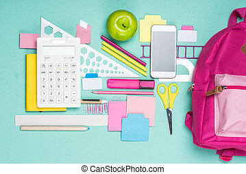 flat lay with various school supplies on colorful surface