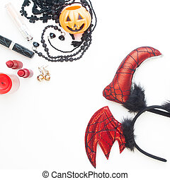 Flat lay woman's accessories for Halloween party on white background