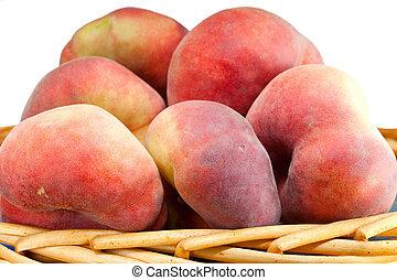 flat peach in a basket