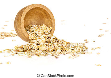 Flat raw rolled oats isolated on white