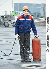 Flat roof covering repair worker