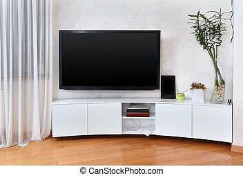 Flat screen TV - Large flat screen TV in modern interior...