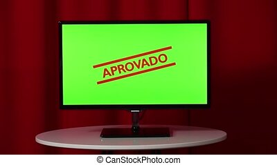 Flat Screen Tv. Standing On A White Table. Green Screen. Approved. Stamp. Red