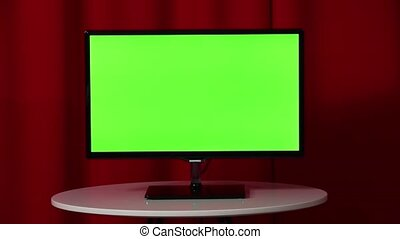 Flat Screen Tv. Standing On A White Table. Green Screen. Top Secret. Red