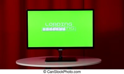 Flat Screen Tv. Standing On A White Table. Green Screen. Wait Loading.