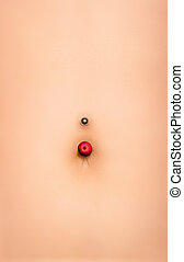 Flat stomach with piercing - Female abdomen with a thin...
