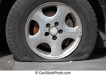 Flat Tire - Flat tire of an old car