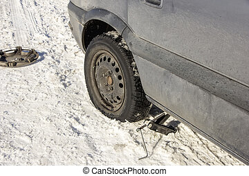 flat tire in the winter snow