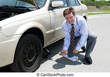 Flat Tire - Jack - A businessman demonstrating how to use a ...