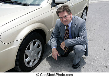 Flat Tire - Oh No - A businessman on the road with a flat ...