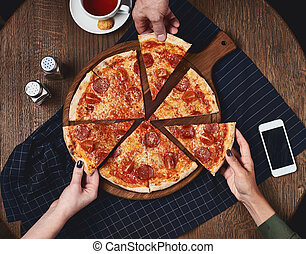 Flatlay. Friends eat pizza. - Flatlay. Close-up of people ...