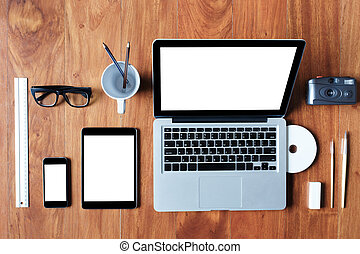 Flat lay of laptop, tablet, phone on wooden table. Background for use anything.