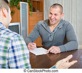 Flatmates discussing tenancy
