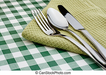 flatware on green Gingham table cloth - knife, fork and...