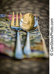 Flatware - Spoon and fork on the garden table.