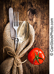 Flatware the old wooden table with a rustic style. - The old...