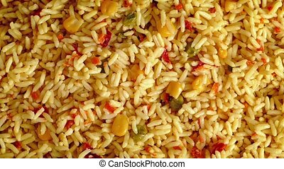 Flavored Rice Dish Rotating - Tasty rice mixture turning...