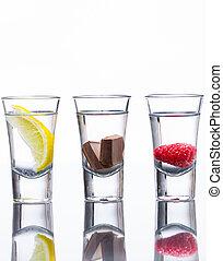 Flavoured vodka shots - Three vodka shots flavoured with...