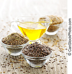 Flax seed and linseed oil - Bowls of whole and ground flax...