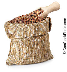 Flax seed in bag with wooden scoop on white
