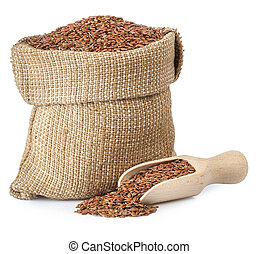 Flax seed in burlap bag on white