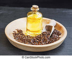 Flax seed oil in transparent bottle with flax seeds