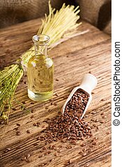 Flax seeds and flax oil on old wooden board