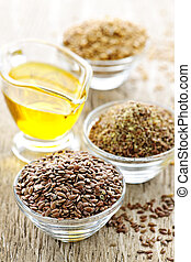 Flax seeds and linseed oil - Bowls of whole and ground flax ...