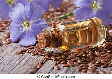 flax seeds, blue flowers and oil close-up horizontal - flax ...