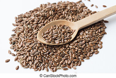 Flax seeds close up on a wooden spoon