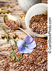 Flax seeds in spoon - Spoon with flax seeds and capsules...