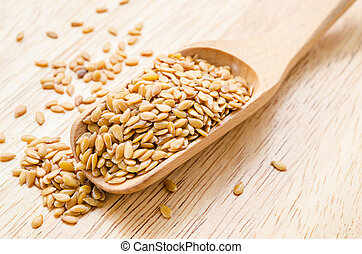 Flax seeds or Linseed close-up in wooden scoop.