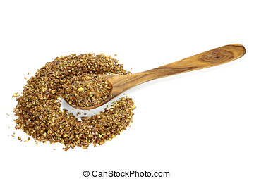 flaxseed grist - wooden spoon with flaxseed grist isolated...