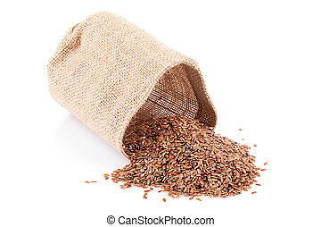 Flaxseed in a small burlap sack isolated on white background...