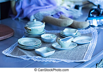 different old things: plates, bowls, vases, home utensils