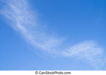 Fleecy clouds against a background blue sky