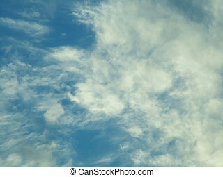fleecy clouds on the blue sky background pattern