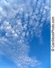 Fleecy clouds.