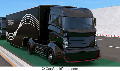 Fleet of autonomous hybrid trucks driving on wireless...