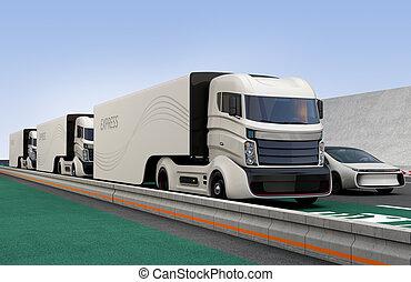 Fleet of autonomous hybrid trucks driving on wireless...