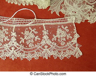 Flemish lace isolated over red - Flemish lace from Belgian...