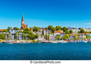 Flensburg cityscape at summer day. Skyline of the old european town. Panoramic view of the small german city