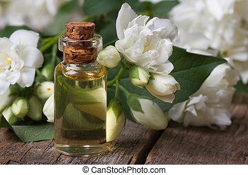 fles, van, geurig, jasmijn, essentie, closeup, en, bloemen