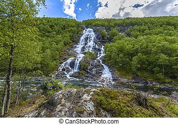 Flesana waterfall in Norway - Flesana waterfall in spring in...