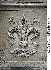 Fleur-de-lis carving - Fleur-de-lis symbol on street of...
