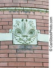 Fleur-de-lis - Beautiful carved fleur-de-lis on the side of...