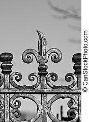 fleur-de-lis - detail of ornate wrought iron fence against...